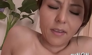 Horny young nurturer gets fingered and teased with fake penis