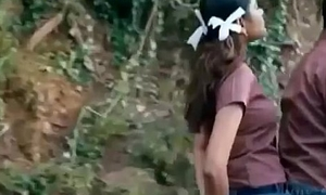 Schoolgirl Pressing their way tight Chest to a guy on Bike