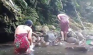 Beautiful girls having bath outdoor